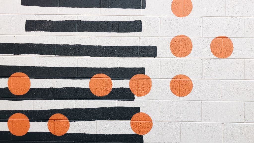 A wall with a random pattern of stripes and dots.